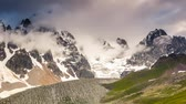 macera : Time lapse clip. Alpine meadows with dramatic sky at the foot of  Mt. Ushba. Upper Svaneti, Georgia, Europe. Caucasus mountains. Beauty world. HD video (High Definition) Stok Video