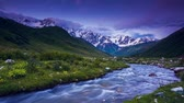 szczyt : Time lapse clip. River in mountain valley at the foot of  Mt. Shkhara. Upper Svaneti, Georgia, Europe. Caucasus mountains. Beauty world. HD video (High Definition)
