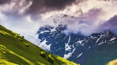 магия : Time lapse clip. Dramatic sky at the foot of  Tetnuldi glacier. Upper Svaneti, Georgia, Europe. Caucasus mountains. Beauty world. HD video (High Definition) Стоковые видеозаписи