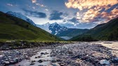 szczyt : Time lapse clip. River in mountain valley at the foot of Tetnuldi glacier. Upper Svaneti, Georgia, Europe. Caucasus mountains. Beauty world. HD video (High Definition). Wideo