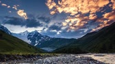 flora : Time lapse clip. River in mountain valley at the foot of Tetnuldi glacier. Upper Svaneti, Georgia, Europe. Caucasus mountains. Beauty world. HD video (High Definition). Stock Footage