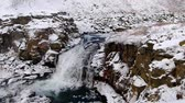 no name waterfall cover with snow in iceland