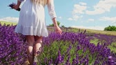 outdoors : Hippie girl walking in lavender field, summer freedom concept