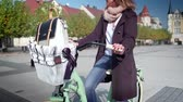 bisiklete binme : Beautiful young woman riding bicycle in the small cozy town