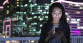 hk : Woman use of smart phone in Hong Kong Stock Footage