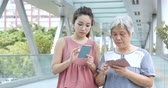 working parents : Mother and daughter using cellphone together