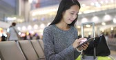 hall : Woman travel with her cellphone in airport Stock Footage