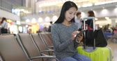 aeronave : Woman use of mobile phone in airport
