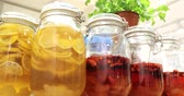 coffee cherries : Canned compotes fruit syrup in preservation glass jars Stock Footage