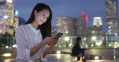 hk : Woman use of cellphone at night Stock Footage