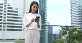 asian architecture : Young Woman use of smart phone in city