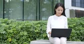 Young business woman work on laptop computer at park Wideo