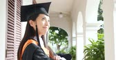graduação : Woman wearing graduation gown and think of future