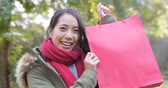 Happy woman holding a red shopping bag Wideo