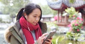 one use : Woman listen to music on mobile phone in china
