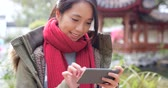 Woman playing mobile phone app at outdoor