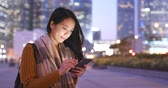 hk : Woman use of mobile phone at outdoor Stock Footage