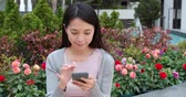 one use : Woman working on mobile phone in city Stock Footage