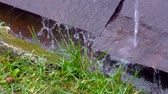 gutter system : Rainy water drains down the iron plates