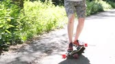 men : Top view of a close-up of a skateboarder on a long board Super slow shooting Stock Footage