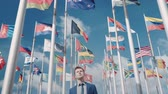 promessa : An optimistic clip of the unity of all countries and nations and a bright future against the background of the flags of all countries and the clear sky and airplane