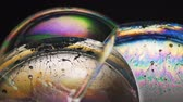 iridescente : Diffraction and interference of light through soap bubbles . Slow motion macro video