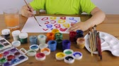 školka : Child learns to write letters with paint