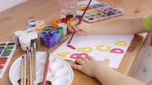 детский сад : Learning to write letters on a white sheet of paper