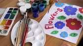 教育 : Childs hand draw colorful flowers
