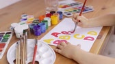 artistik : Preschooler learn how to write letters. Education concept