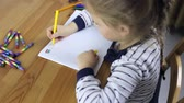 Preschooler girl draws flags