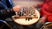 bishop : Two men playing chess in a coffee shop. Stock Footage