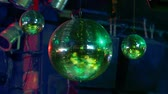 discoteca : The disco ball turning in the night club.