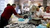 fishmarket : Buyers and sellers at the fishmarket. Stock Footage