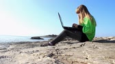 loughing : Girl with a laptop on the beach.