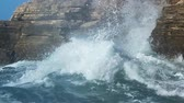 wind breaker : Waves hitting at the cliff. Stock Footage