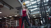 snatch : Kettlebell fitness, young female athlete doing strength exercises in the gym