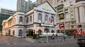 símbolo : GEORGE TOWN, MALAYSIA - CIRCA FEBRUARY, 2015: The restaurant is located in a beautiful old building. The McDonalds Corporation is the worlds largest chain of hamburger fast food restaurants. Stock Footage