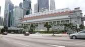 fullerton : SINGAPORE - FEBRUARY 18, 2015: Famous The Fullerton Hotel in Singapore is a five-star luxury hotel located near the mouth of the Singapore River, in Central Business District. Commissioned in 1919. Stock Footage