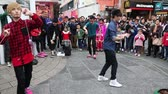 yoyo : HONG KONG - CIRCA FEBRUARY, 2015: Guys a virtuoso playing with a toy yo-yo show the presented on the waterfront of Hong Kong. Promenade on the Kowloon peninsula a popular destination with tourists.