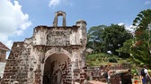 tourism : MALACCA, MALAYSIA - CIRCA JANUARY, 2015: Tourists visit the Porta de Santiago the remaining ruins of the Portuguese A Famosa fortress. Malacca was included in the list of UNESCO World Heritage Sites in 2008.