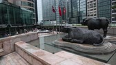 manzara : HONG KONG CIRCA JUNE 2014: Exchange Square is located in the Central district of Hong Kong. On exchange of the square is the building of the HK Stock Exchange the sculpture of the bulls.