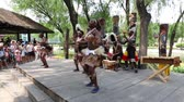 miniatura : BEIJING - CIRCA JUNE, 2015: Tourist resort Beijing World Park is a theme park which contains a small copies of sights of international importance. Africans perform African dance in front of park visitors. Stock Footage