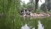 pekin : Pond with a waterfall in the summer park, Beijing