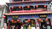 tourism : BEIJING - CIRCA JUNE, 2015: Dashilan shopping street - the famous and very ancient commercial street in Beijing, with its own, unique and ancient charm and centuries of history. Popular with tourists Stock Footage