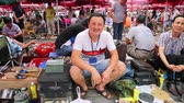 best : BEIJING - CIRCA JUNE, 2015: Panjiayuan Flea Market is located on the street Hua Weili - one of best antiques market in China. It also has the reputation the most inexpensive antiques market in Beijing