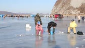 smelt : NAKHODKA, RUSSIA - DECEMBER 19, 2015: In winter, a lot of people catch fish from under the ice in the river Partizanskay. Fishing smelt and saffron cod is a popular activity among the local people.