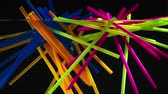 objetos : bright multicolored neon straws falling into clear water on black background