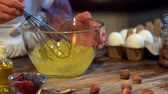 schneebesen : whisk in glass bowl at wooden table