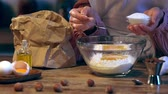 nut : cooking in bowl with flour and eggs Stock Footage